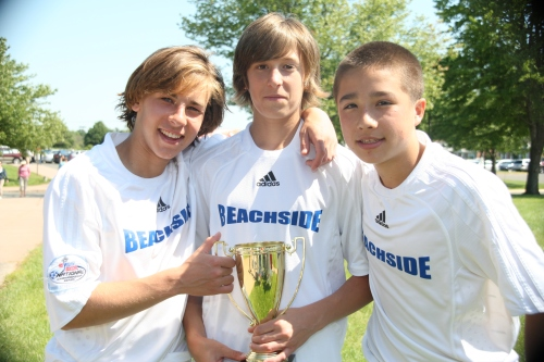 Jake Malowitz, Taylor McNair and Aaron Liu with their Beachside team's 2nd straight state trophy
