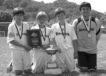Kyle Zajec, Jordan McNair, Griffen Garner and Johnny Osorio pose with their U-12 hardware.