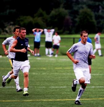 (From right) Juniors Sean Gallagher, Brendan Lesch and Steven Denowitz lead their group in an early fitness run.