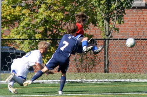 Jake Krosse and James Hickok share a special defensive moment against Darien. (Photo by MaryGrace Gudis)