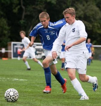 Dylan Evans rounds the corner against Fairfield Ludlowe.  (Photo by Carl McNair)