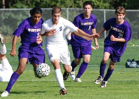 Sean Gallagher muscles his way past a horde of Westhill Vikings.  (Photo by Lisa Krosse)