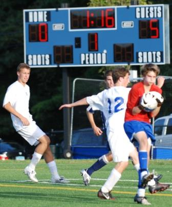 James Hickok saves in traffic iin the waning moments against Darien.  (Photo by Lisa Krosse)