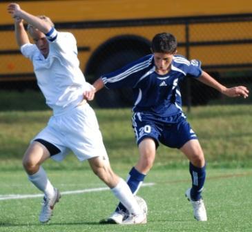 Court Lake handles a Darien defender.  (Photo by Lisa Krosse)