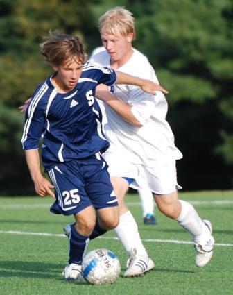 Sophomore Jake Malowitz shields against a Waver.  (Photo by Lisa Krosse)