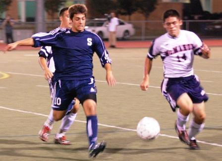 Matteo Marzoli moves upfield against Brien McMahon.  (Photo by Lisa Krosse)
