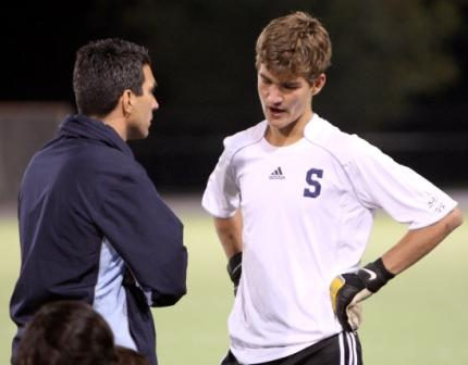 Michael McCarthy explains one of his decisions to an interested keeper coach Tom Henske during halftime. (Photo by Carl McNair)