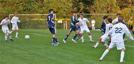 Nick Cion (13) powers in a goal.  Connor Walsh, Luke Yeager, Steve Denowitz and Dylan Evans all stand ready to help.  (Photo by Carl McNair)
