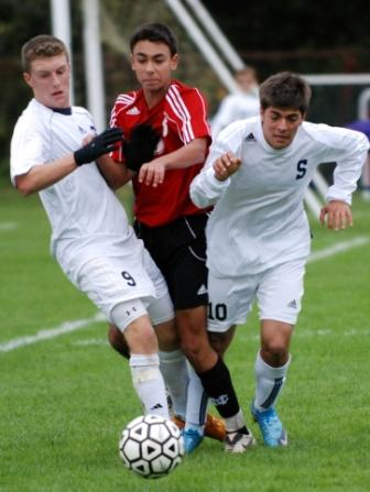 Brendan Lesch and Matteo Marzoli sandwich a New Canaan defender.  (Photo by Lisa Krosse)