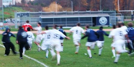 Staples boys soccer celebrates PK win over Newtown