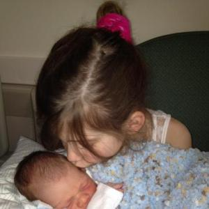 Ellery is already a big sister to William.