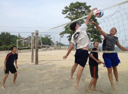 Sterling Price (white) and Foster Goldberg battle it out in beach volleyball. Diego Alanis (left) and James Rubin provide help.