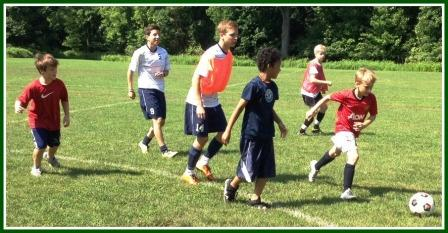 Diego Alanis (left) and Jack Scott try to keep up with a pack of Saugatuck Elementary School kids.