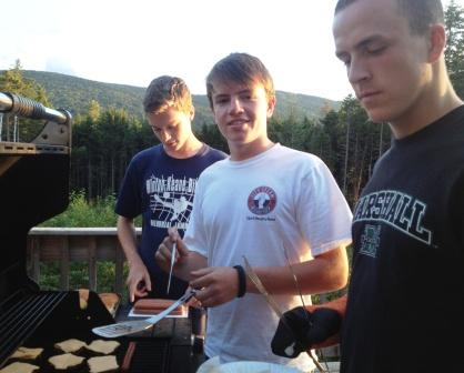 Patrick Beusse, Charlie Leonard and Connor Weiler man the grill.