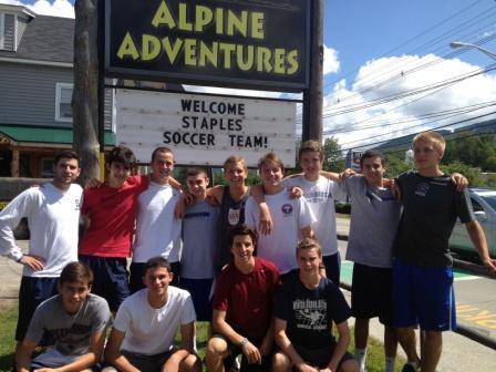 The Wreckers gather before their zip line adventure. Thanks to the sign, all of Lincoln, New Hampshire knew they were there.